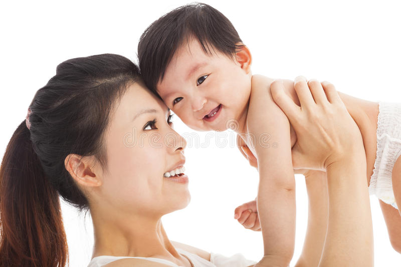 Happy mother holding adorable child baby boy stock photography