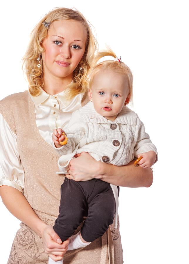 Mother holding daughter royalty free stock images