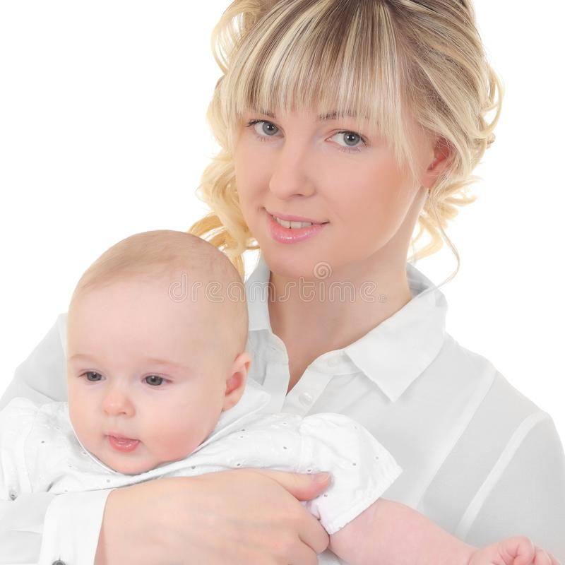 Happy mother holding her baby. Young happy mother holding her baby stock photo