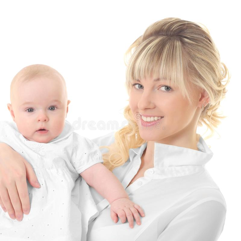 Happy mother holding her baby. Young happy mother holding her baby royalty free stock image
