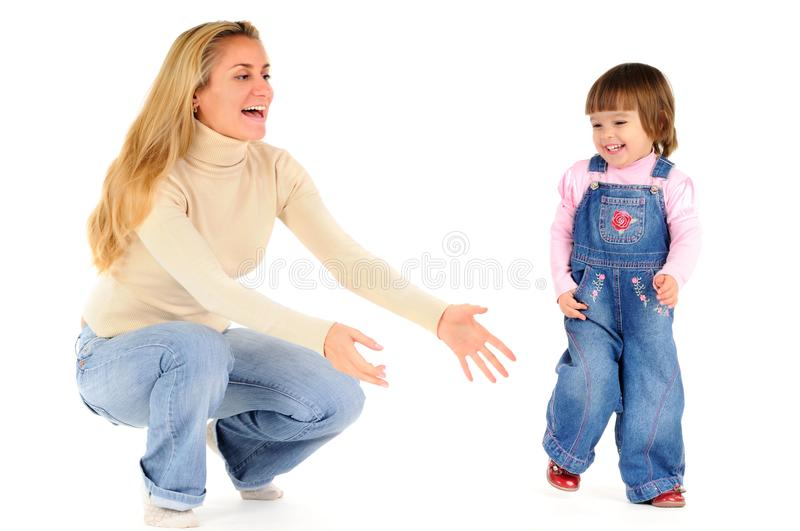 Happy mother holding and playing with her little daughter stock photo