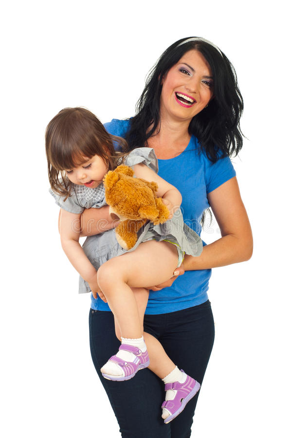 Happy mother holding toddler girl royalty free stock photography