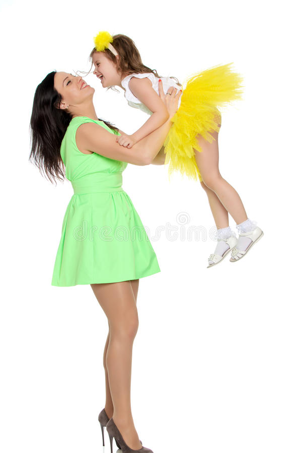 Happy mother holding a young daughter. royalty free stock photos