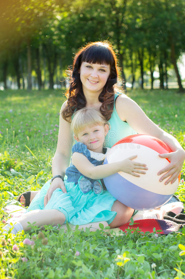 Happy mother hugging her daughter in nature stock images