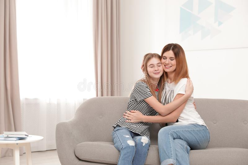 Happy mother hugging her teenager daughter royalty free stock image