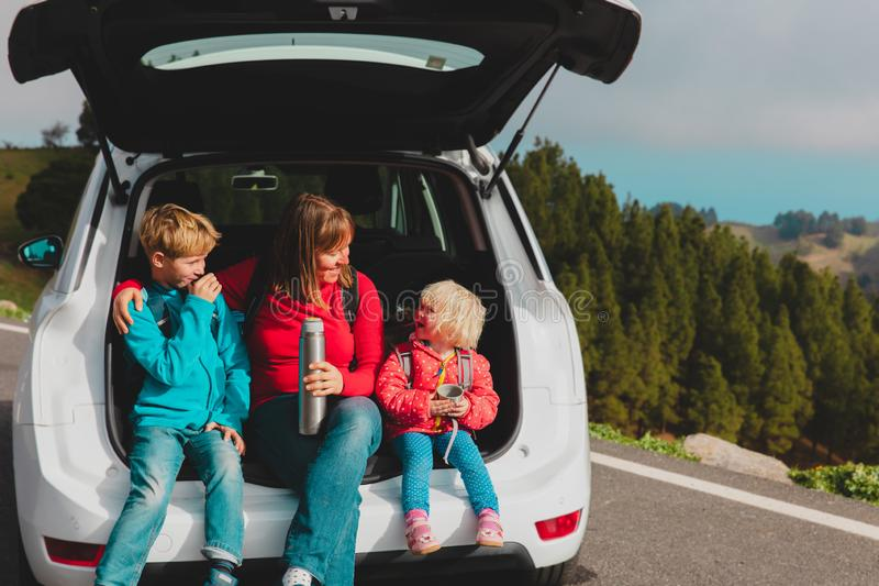 Happy mother with kids enjoy travel by car in nature royalty free stock photos