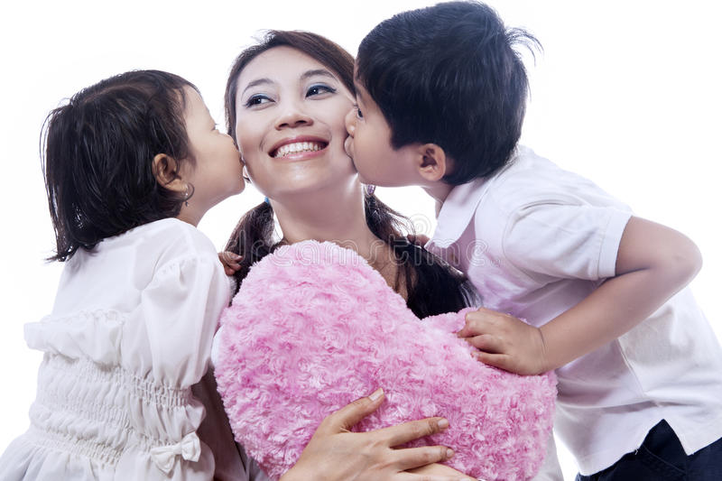 Download Happy Mother Kissed By Children - Isolated Stock Photo - Image: 28641016