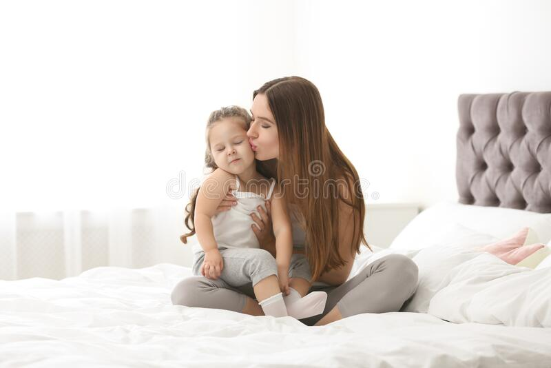 Happy mother with little daughter royalty free stock photos