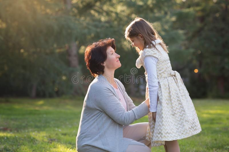 Happy mother and little daughter looking at each other, mother holding little girl, mother`s day concept stock photos