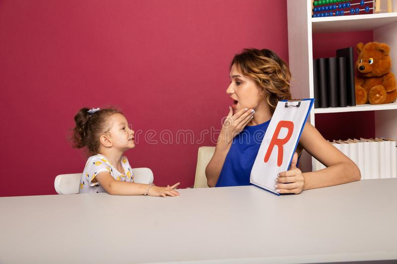 Happy mother with little kid studying together. Preschool studying concept. Happy mother with little kid studying together. Preschool studying concept royalty free stock photo