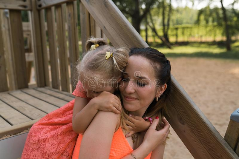 Happy mother playing with her little baby girl daughter and having fun - Young caucasian white mom wearing summer bright royalty free stock photos