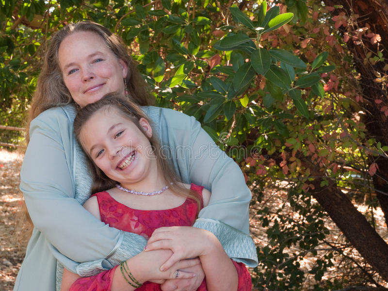 Happy mother and pre-teen daughter royalty free stock photography