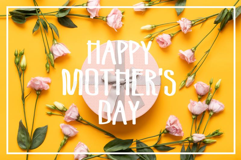Happy Mother`s Day Background. Bright Yellow and Pastel Pink Colored Mother Day Background. Flat lay greeting card with gift box. Happy Mother`s Day Background stock photo