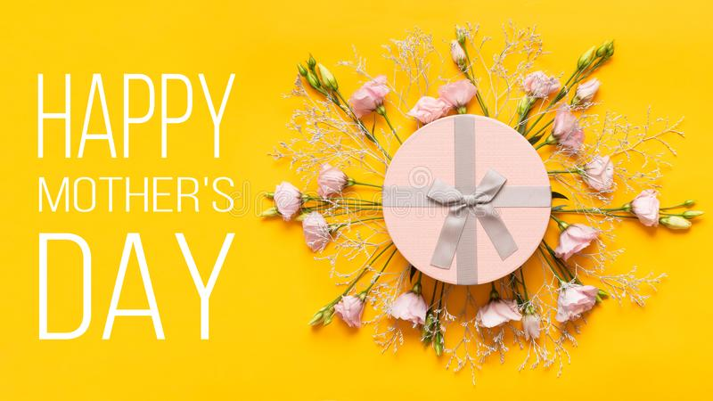 Happy Mother`s Day Background. Bright Yellow and Pastel Pink Colored Mother Day Background. Flat lay greeting card. stock photos