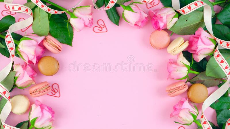 Mother`s Day background of pink roses and macaron cookies on pink wood table. stock illustration