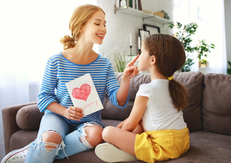 Happy mother`s day! Child daughter congratulates moms stock photography