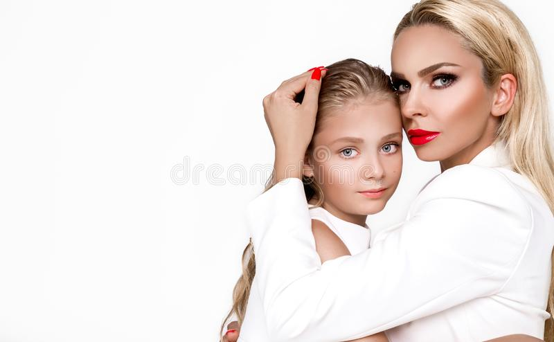 Happy mother`s day! child daughter and mother embraced, cuddling - Image stock photography