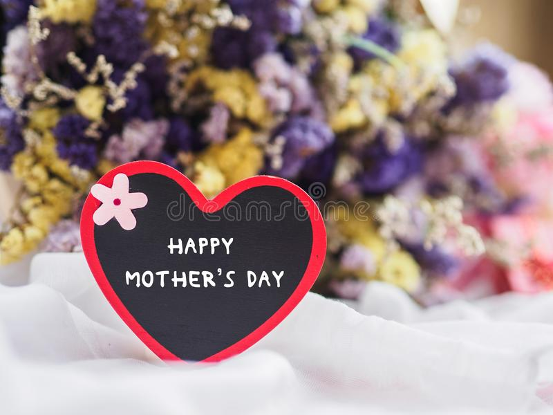 Happy mother`s day concept. wooden tag with HAPPY MOTHER`S DAY t stock images