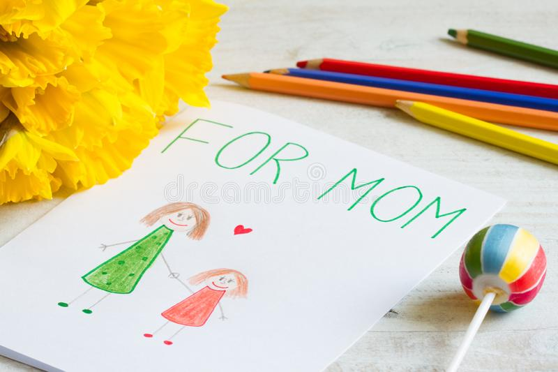 Happy mother`s day drawing from a child for mom with greetings royalty free stock photos