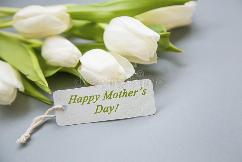 Happy Mother`s Day greeting with white tulips bouquet royalty free stock photos
