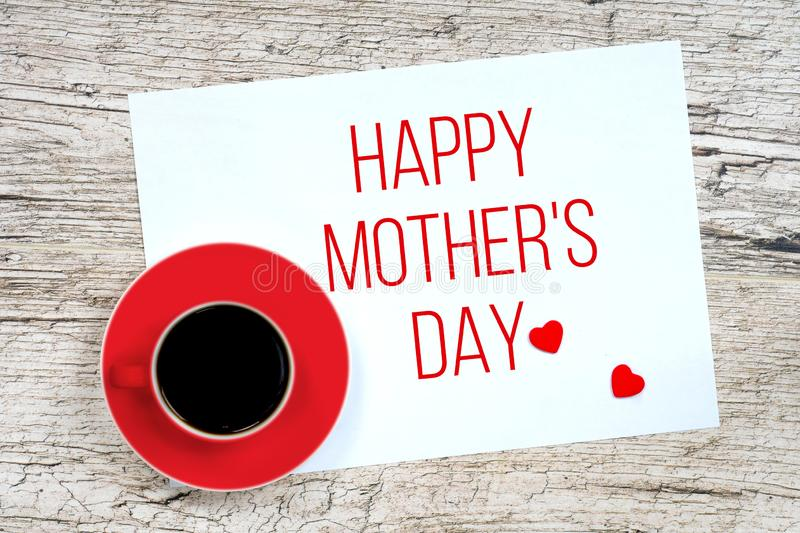 Happy mother`s day, greetings card with coffee cup. Happy mother`s day, greetings card with red coffee cup and wooden hearts stock photos