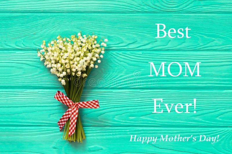 Happy Mother`s day text on blue rustic wooden background. greeting card concept spring flowers flat lay royalty free stock photos