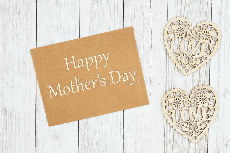 Happy Mother`s Day text on a brown greeting card. Retro card for mom, Happy Mother`s Day text on a brown greeting card with wood hearts on weathered whitewash royalty free illustration