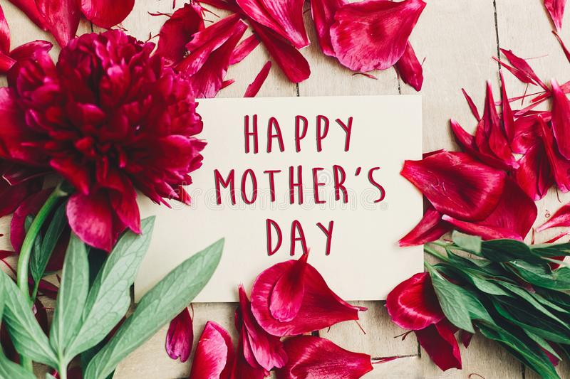 Happy mother`s day text sign on craft paper card beautiful red p royalty free stock photos