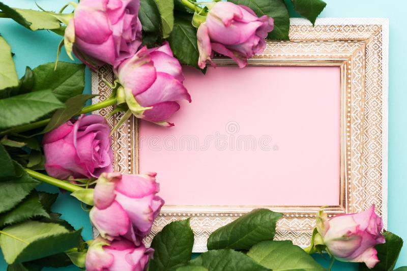 Happy Mother`s Day, Women`s Day, Valentine`s Day or Birthday Flat Lay Background. Beautiful wooden vintage picture frame and roses stock photo