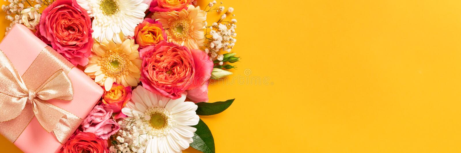 Happy Mother`s Day, Women`s Day, Valentine`s Day or Birthday Living Coral and Yellow Banner. Floral flat lay greeting card. Happy Mother`s Day, Women`s Day royalty free stock photo