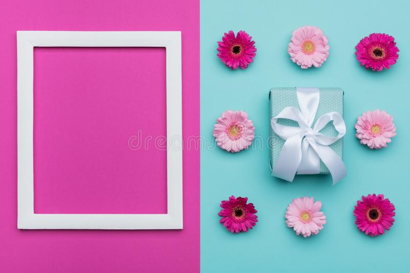 Happy Mother`s Day, Women`s Day, Valentine`s Day or Birthday Pastel Blue and Pink Candy Colour Background. Floral flat lay stock image