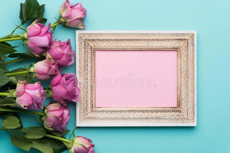 Happy Mother`s Day, Women`s Day, Valentine`s Day or Birthday Flat Lay Background. Beautiful picture frame, fresh pink roses. Happy Mother`s Day, Women`s Day stock photos
