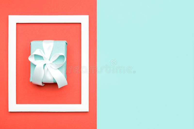 Happy Mother`s Day, Women`s Day, Valentine`s Day or Birthday Living Coral Background. Flat lay minimal greeting card with gift box. Happy Mother`s Day, Women`s stock images