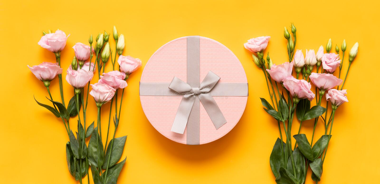 Happy Mother`s Day, Women`s Day, Valentine`s Day or Birthday Yellow and Pastel Pink Colored Banner. Flat lay greeting card. Happy Mother`s Day, Women`s Day stock photography