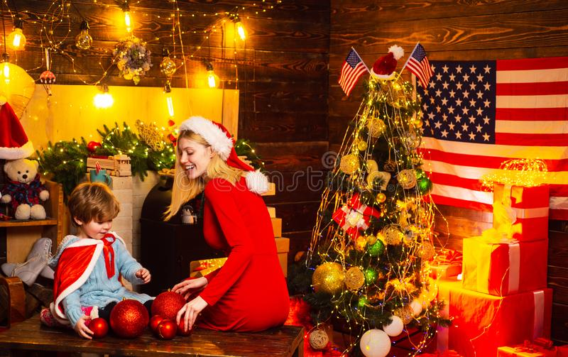 Happy mother and son celebrating New Year together. Mum with her little baby boy decorate sweet home at Christmas eve royalty free stock photos