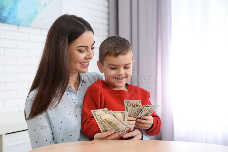 Happy mother and son with money royalty free stock photography