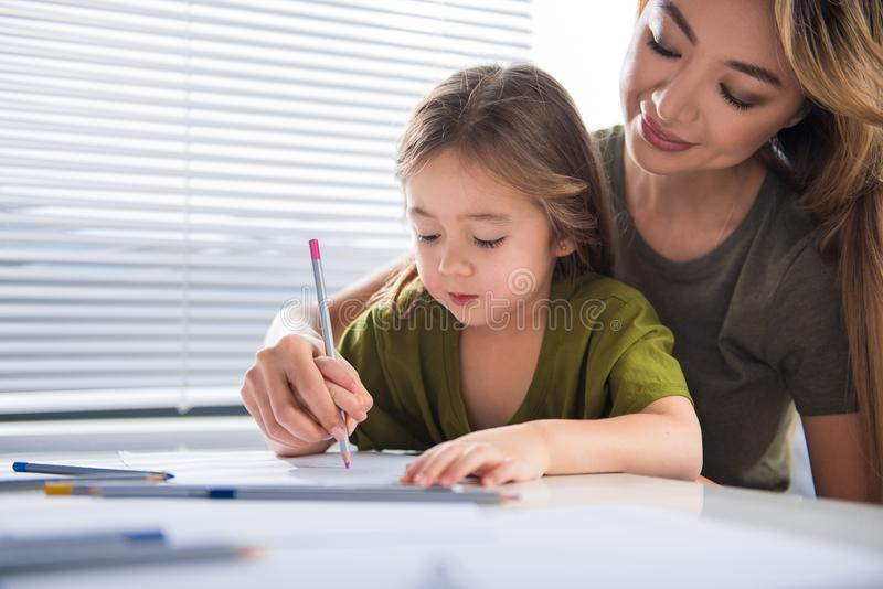 Happy mother is spending time with her child stock image