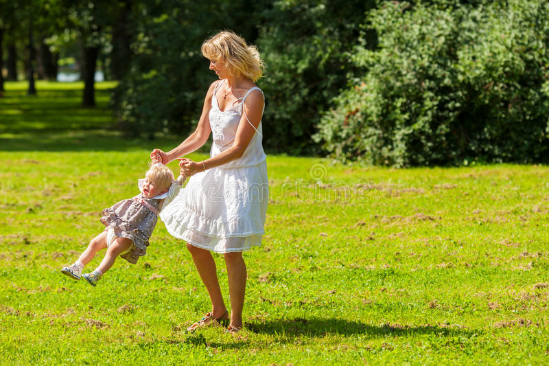 Happy mother spinning royalty free stock photography