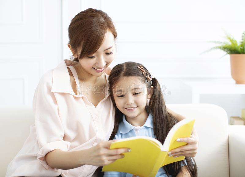Mother studying with  little girl  at home royalty free stock photos