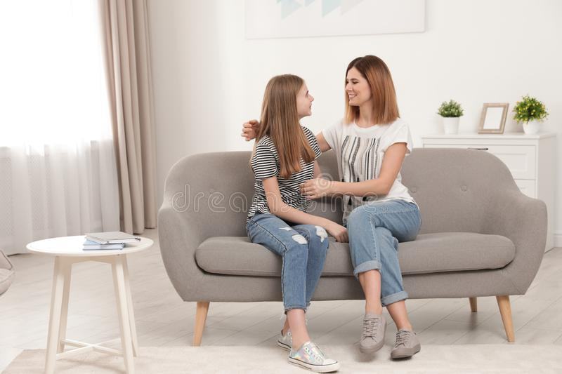 Happy mother talking with her teenager daughter royalty free stock photo