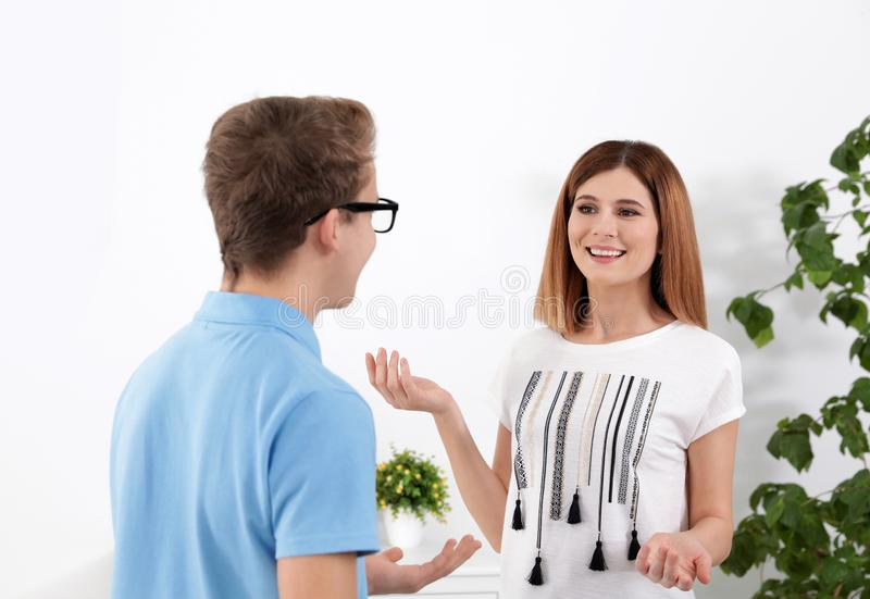Happy mother talking with her teenager son stock photo