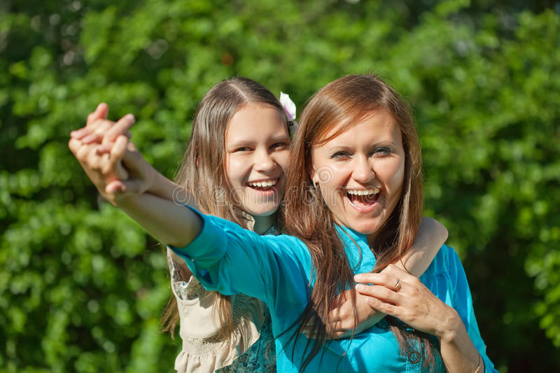 Happy mother with teenager daughter royalty free stock photo