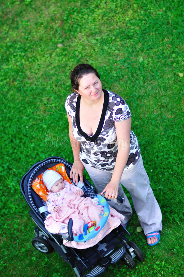 Download Happy Mother Walking With Baby Royalty Free Stock Image - Image: 21670586
