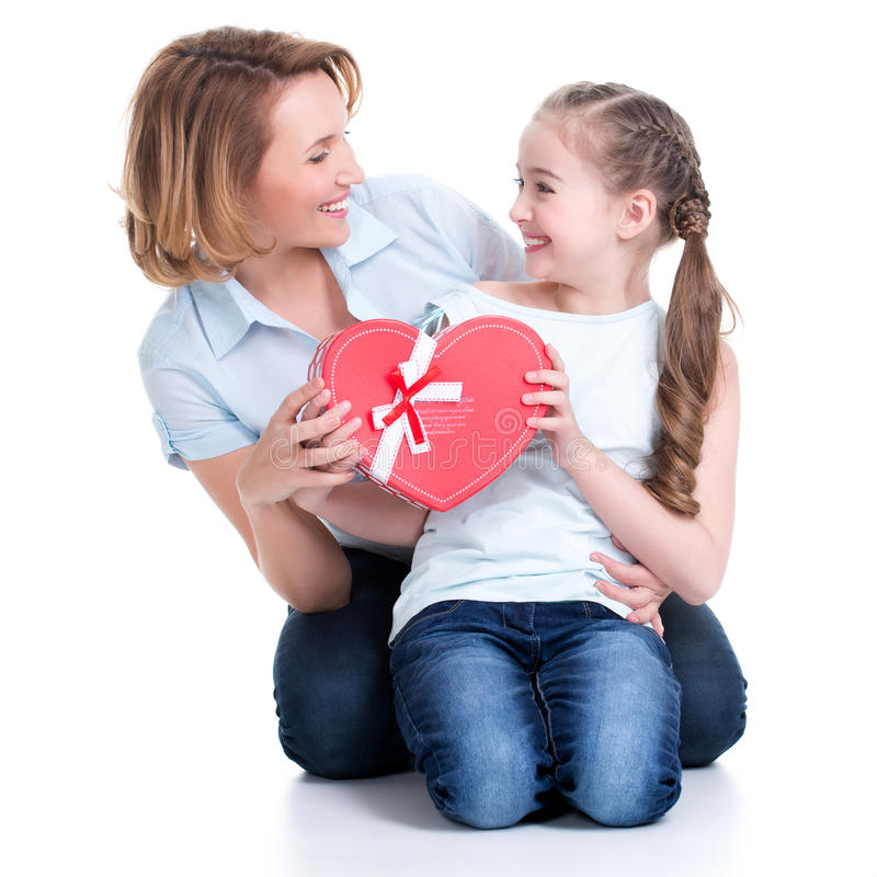 Happy mother and young daughter hold gift for birthday. Portrait of happy mother and young daughter hold gift for birthday - isolated royalty free stock images