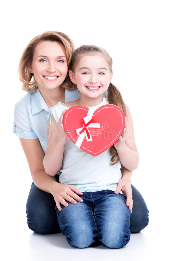 Happy mother and young daughter hold gift for birthday. Portrait of happy mother and young daughter hold gift for birthday - isolated stock photos