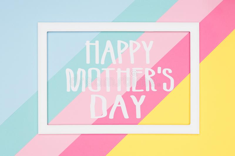 Happy Mothers Day abstract geometrical pastel blue, pink and yellow paper flat lay background. Minimalism greeting card. Happy Mothers Day abstract geometrical stock image