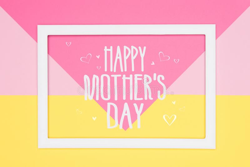 Happy Mothers Day abstract geometrical pastel pink and yellow paper flat lay background. Minimalism greeting card. royalty free stock images