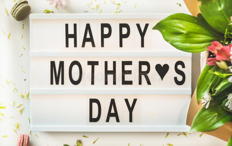 Happy mothers day. A beautiful bouquet of flowers with hot tea on the table. Breakfast in bed on Mothers day royalty free stock images