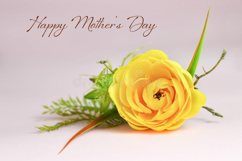 Happy Mothers Day card. Yellow artificial rose on pink background royalty free stock image