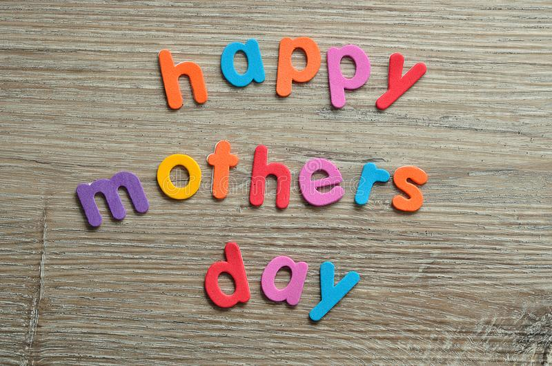 Happy mothers day in colorful letters royalty free stock photo